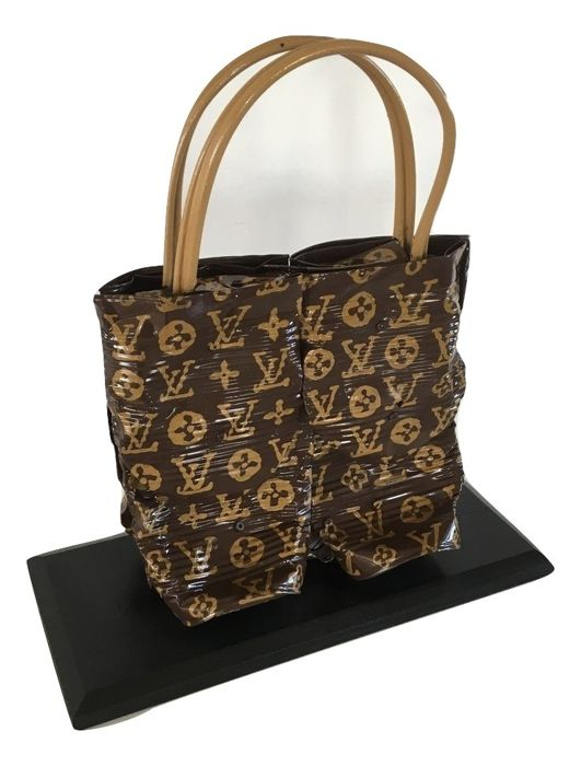 Norman Gekko - « Recycled Louis Vuitton's handbag »