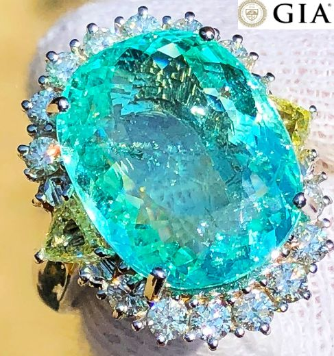 Cocktail ring with very rare GIA-certified 15.97 ct Paraiba tourmaline, white diamonds totalling 1.20 ct, VVS1, D/E, and fancy yellow diamonds totalling 1 ct, VS1