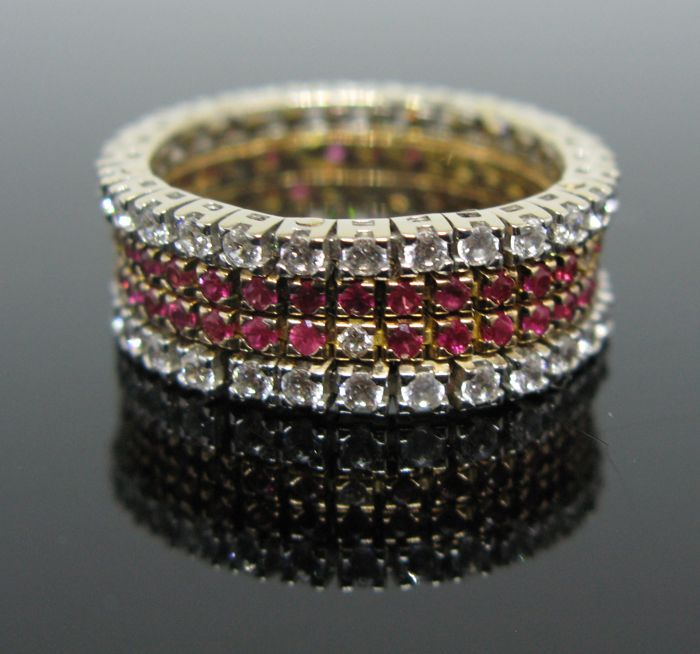 18 kt pink and white gold four bands eternity ring set with 66 natural ruby round-faceted cut tot 1,32 ct, 5 diamonds round-brillant cut tot 0,10 ct F/VVS1 and 56 white sapphires round-brillant cut tot 1,68 ct  + No reserve price +
