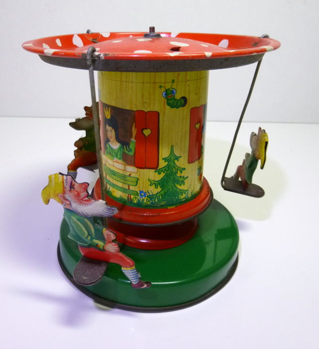 "Schopper 1960s tin carousel ""Snow white and the Dwarfs"" (Western-Germany)."