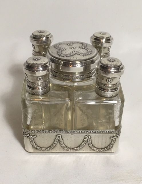 French silver toilet set in holder, ca 1900