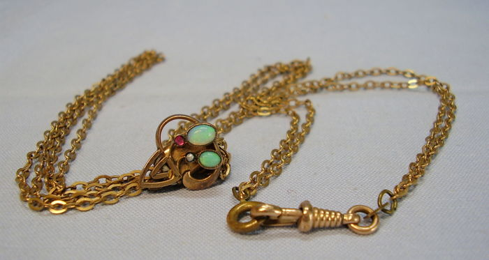 Watch chain with slider with natural solid opals (1 ct in total) and small freshwater pearl as well as a Verneuil ruby