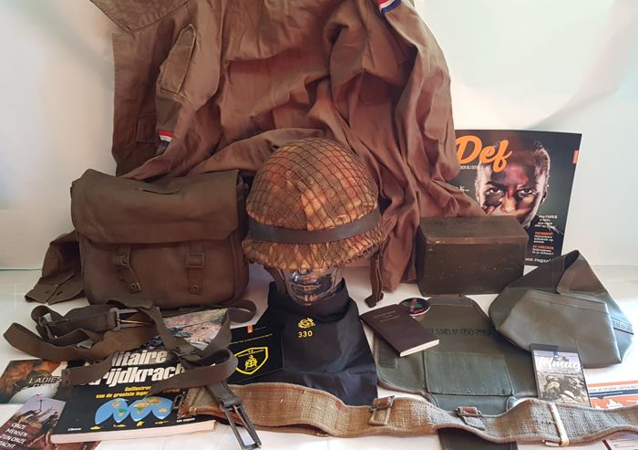 Very large lot Militairia: inner and outer helmet, coat, webbing backpack, belt, laundry bag, books etc etc -all original Militaria - Dutch Indies /the Netherlands/Belgium - from 1954