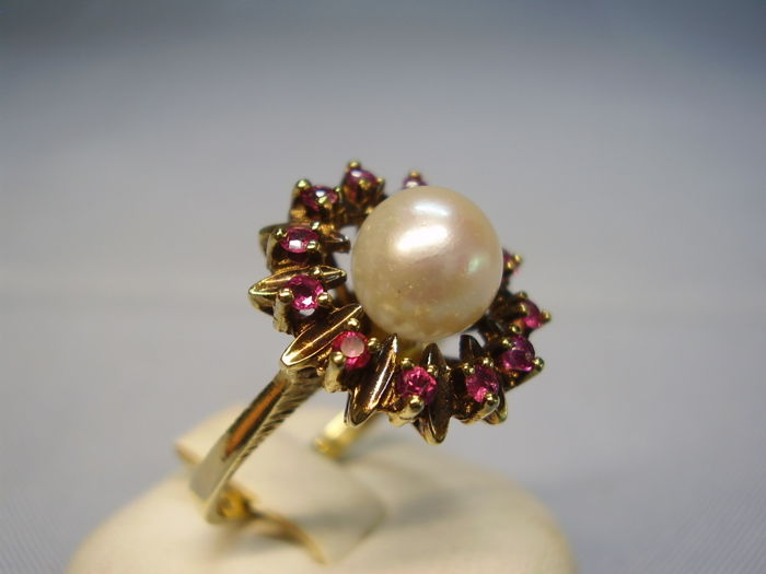 Antique 14 kt ring with large, genuine Akoya pearl and natural ruby entourage weighing 0.48 ct