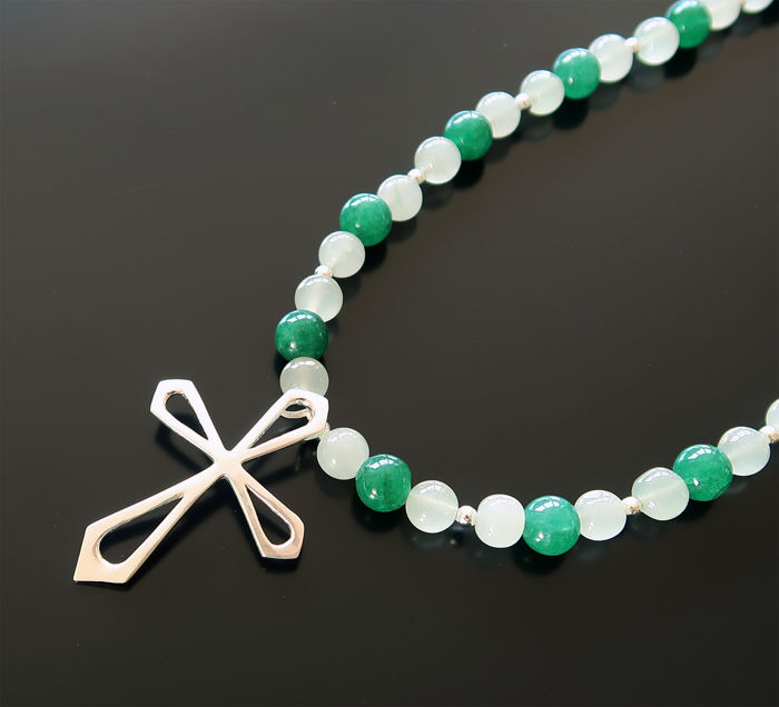 Necklace made of aquamarine, emeralds and silver, adorned with a sterling silver cross.