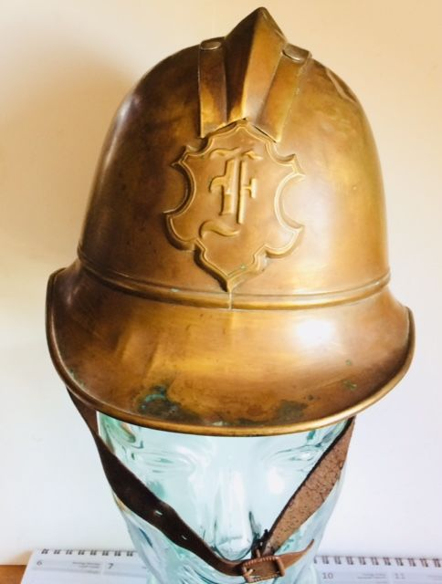 Fire fighter helmet, circa 1920