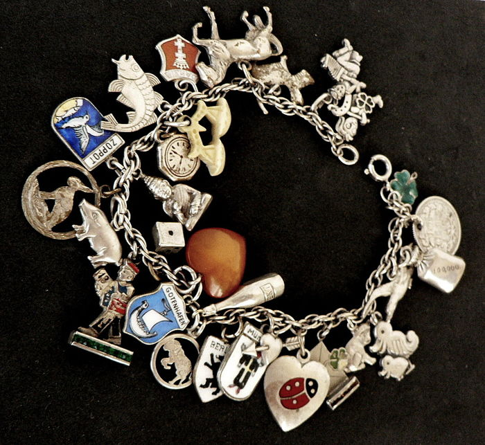 Old 835 silver bracelet, charm bracelet, hallmarked, richly endowed with charms, many with 835 and 800 hallmarks, amber, bone, enamel etc.!
