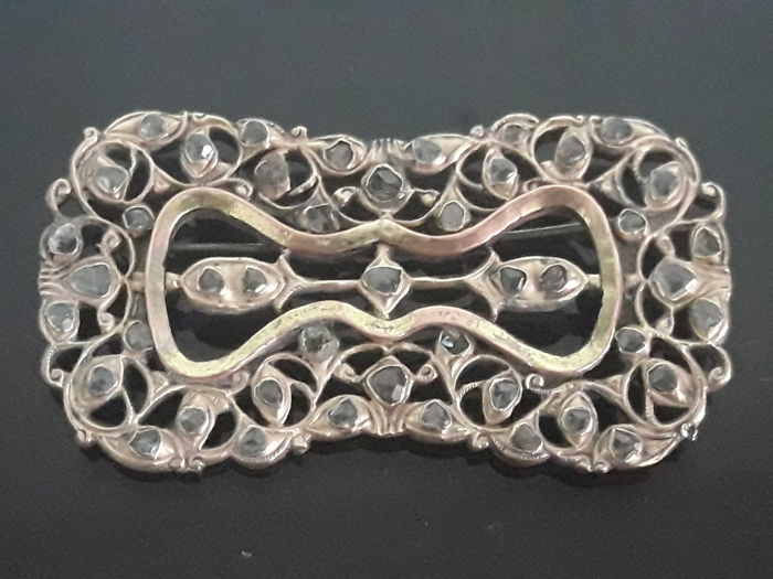 Metal brooch from the 18th century with rock cut diamonds