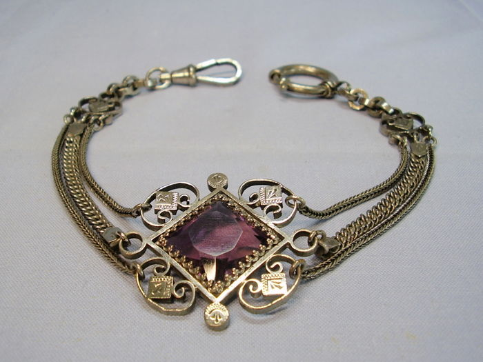 antique watch chain with square, amethyst-coloured paste glass in ornate setting on 3-row chains