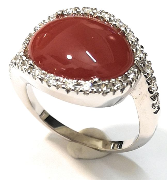 Dark coral ring with diamonds