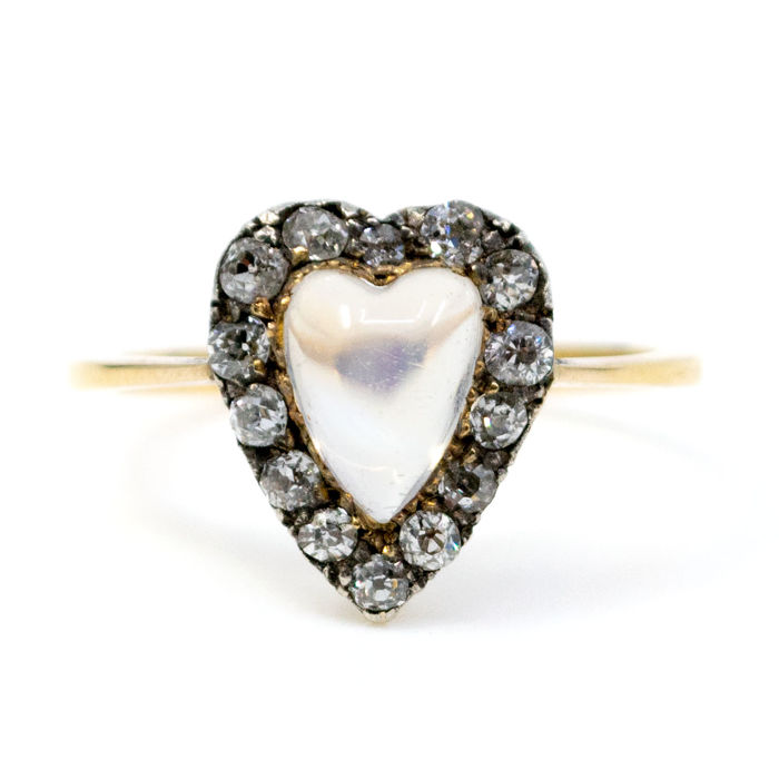 This ring features heart-shaped Moonstone surrounded by 0.30ct Old Mine Cut Diamonds in 14k Gold.