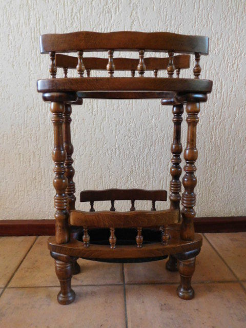 Old ornate solid wooden umbrella stand