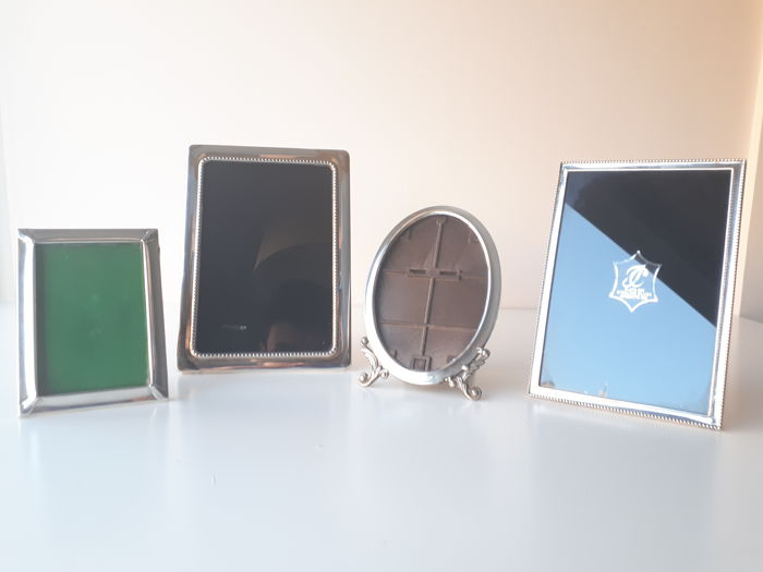 A collection of three silver photo frames, of different shapes and sizes - Spain