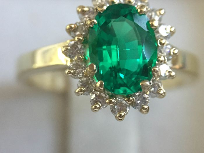 14k yellow gold diamonds and emerald ring. Ring size 7 (resizable)