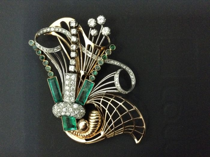 Brooch, gold 18k, platinum, diamonds 5,5ct, emerald 9,9 ct.
