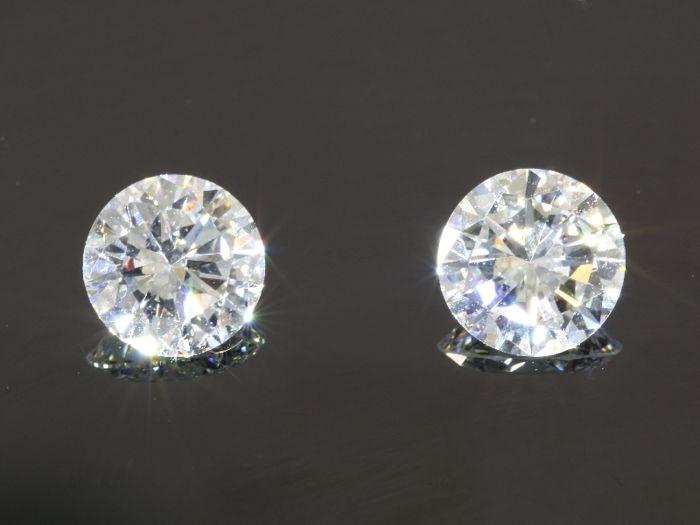 2 Certified brilliant cut diamonds (1) 1.02 ct & (2) 1.02ct, both are G - VVS1