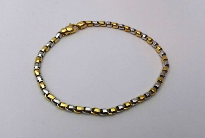 Men's bracelet in 18 kt white and yellow gold. Weight: 12.90 g.