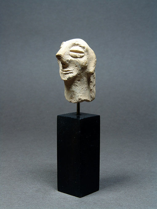 Near Eastern Terracotta Female Head - H. 4.1 cm