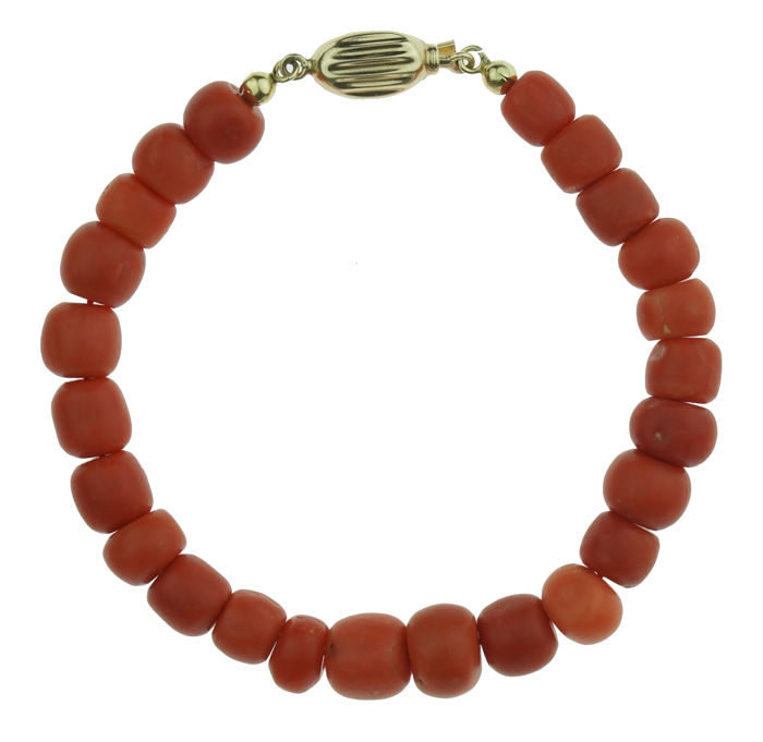 Fine red coral cheese bracelet on  14 karat gold clasp