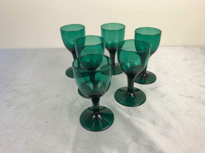 Five green crystal wine glasses, the Netherlands, circa 1900