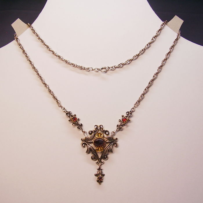 Antique, signed necklace with large garnet rose weighing 5 ct, partially gold plated