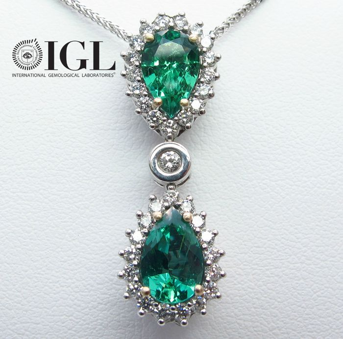 A two Emerald Zambia gemstones and Diamond drop pendant, 2.23 ct. mounted in 18K White gold. Certified IGL