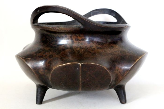 Large bronze incense burner in the lotus blossom shape on three legs with bridge handles and marking on the bottom - probably 19th century