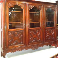 bookcase in massif walnut in Louis XV style, France, late 19th century