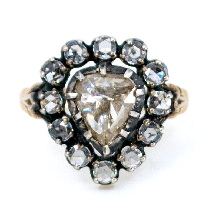 Ring featuring pear-shaped 0.75ct (O P1) Rose Cut Diamond surrounded by 0,30ct (K SI) Rose Cut Diamonds in 14k Gold and Silver.