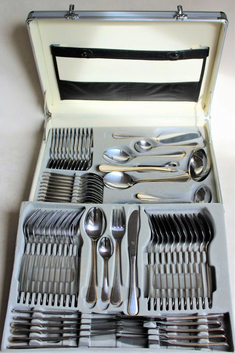 High quality 72-piece stainless steel Princess cutlery with gold trim - complete for 12 people - in the lockable attaché cases