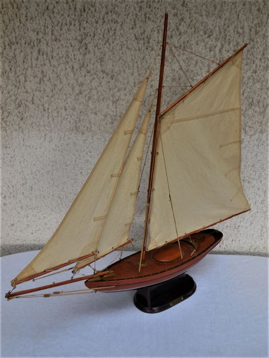 Old large wooden sailing/sailing yacht in fine wood with base and