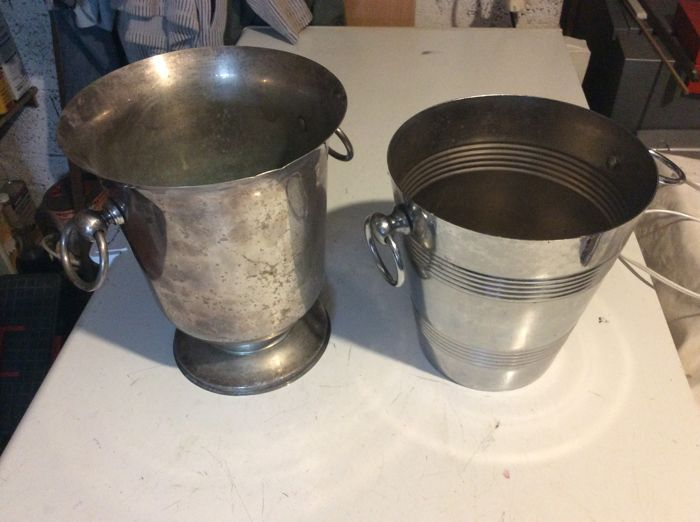 Champagne buckets, one in silver-plated metal and one in stainless steel