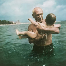 Robert Capa (1913-1954) - Pablo Picasso playing in the water with his son Claude, Vallauris, France, 1948