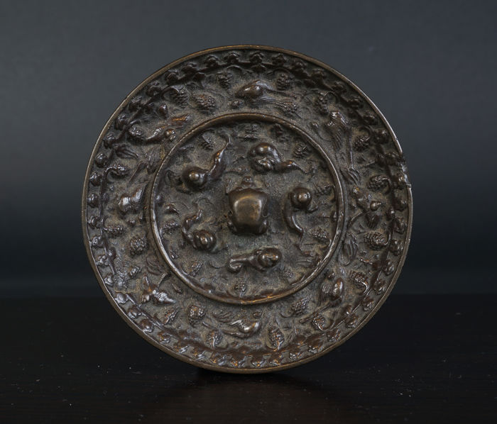 Top bronze mirror with squirrel, birds and grapes - China - Ming period