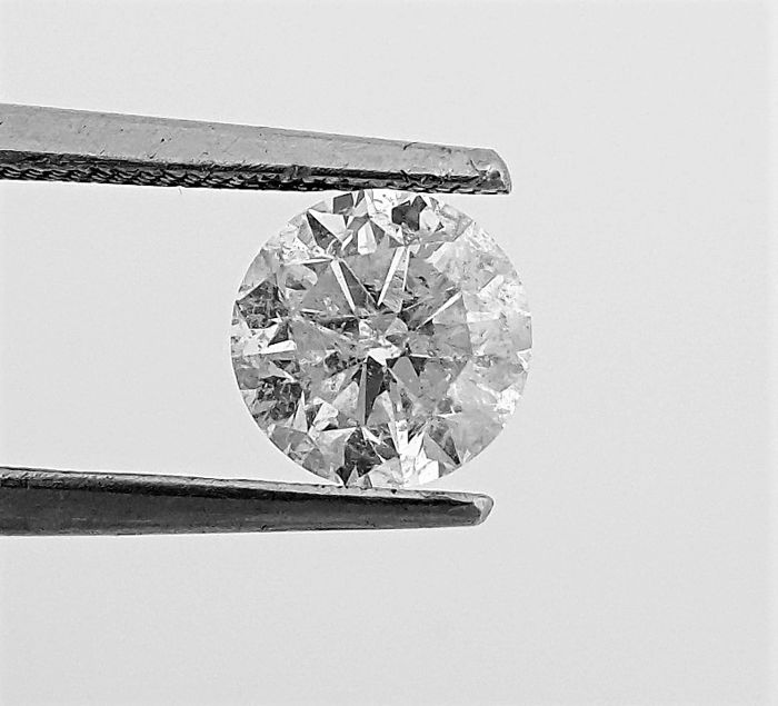 Round Brilliant Cut  - 1.02 carat  - F color  - SI1 clarity  - 3 x EX - Natural Diamond  - With AIG Big Certificate + Laser Inscription On Girdle