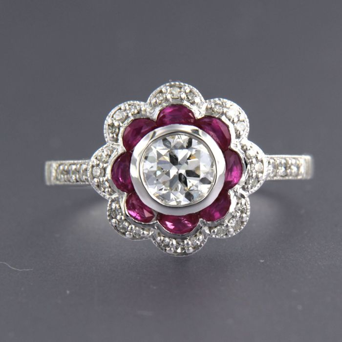 14 kt white-gold ring in Art Deco style, set with rubies (1.55 ct) and diamonds of approx. 0.73 ct in total, ring size: 17.25 (54)