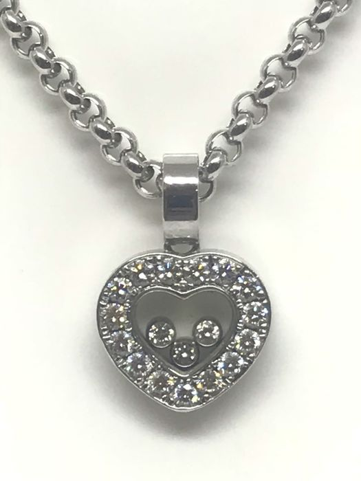 "Chopard - ""Happy Diamonds"" necklace in 18 kt (750/1000) white gold, 3 diamonds of 0.03 ct movable under glass + 15 diamonds around 0.04 ct. Necklace length: 41 cm + Pendant with bezel: H 2.3 cm x W 1.5 cm"