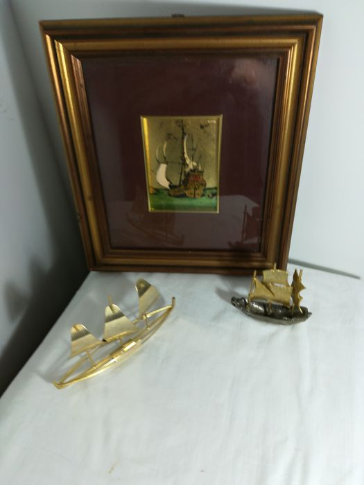 Silver plated sailboat, gilded brass sailboat and decorative helm with sailing ship
