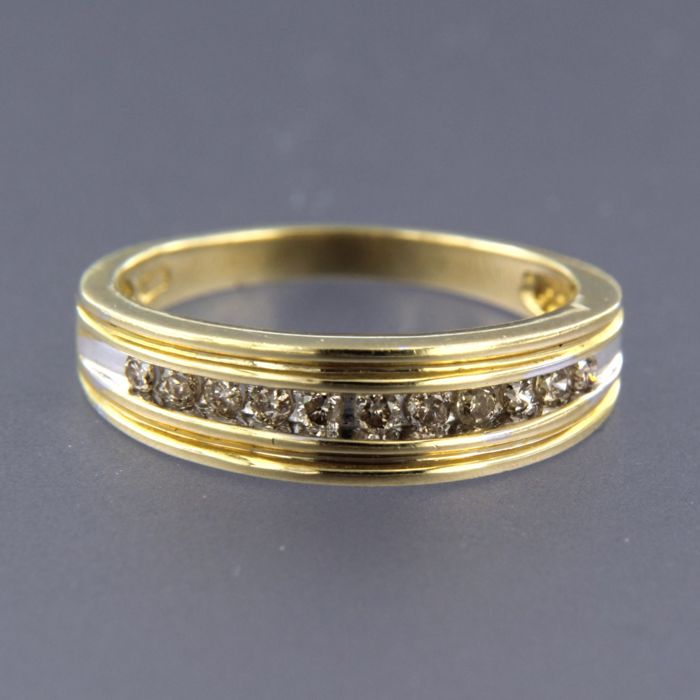 14 kt, bi-colour gold ring set with 11 brilliant cut diamonds, approx. 0.33 carat in total - ring size 17.5 (55)