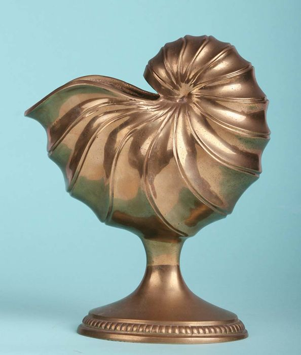 A heavy (2 kg) bronze nautilus shell on foot.