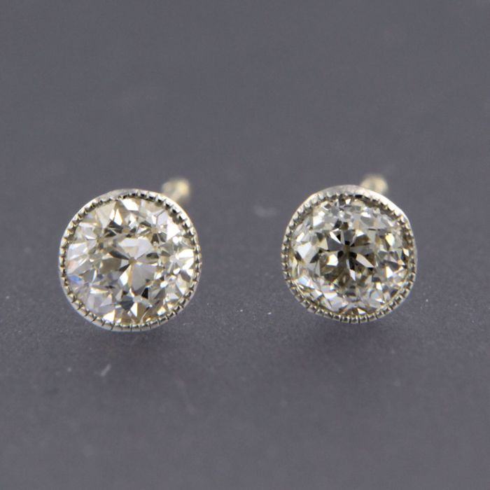 14 kt bi-colour gold ear studs set with Bolshevik cut diamonds of approx. 0.64 ct in total - 4.5 mm wide