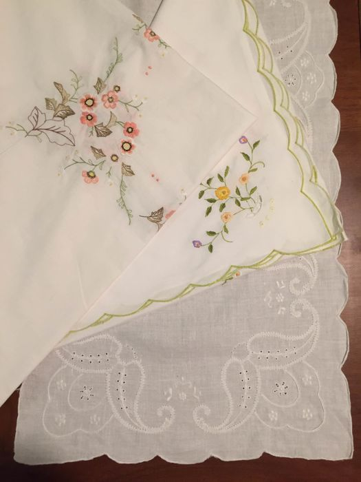 Tea tablecloths and embroidered linen centrepiece