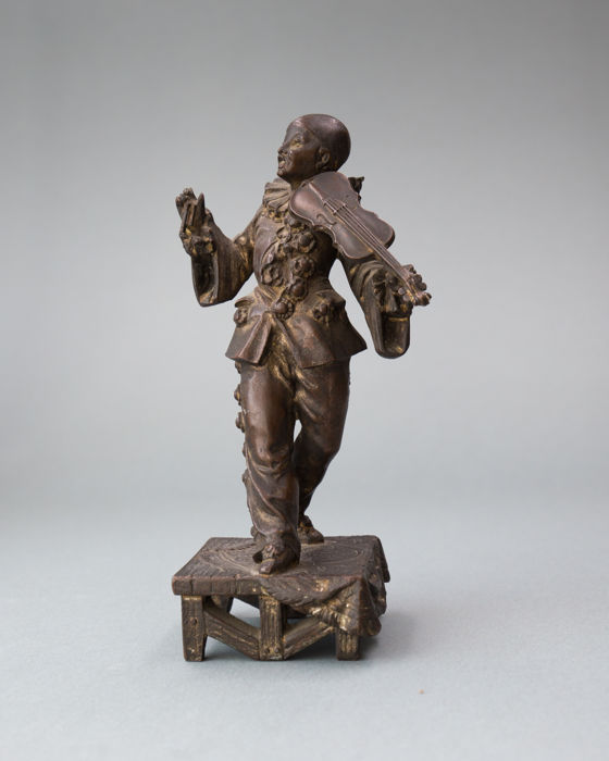 A zamak sculpture of Pierrot with a violin, France/Austria, ca.1910
