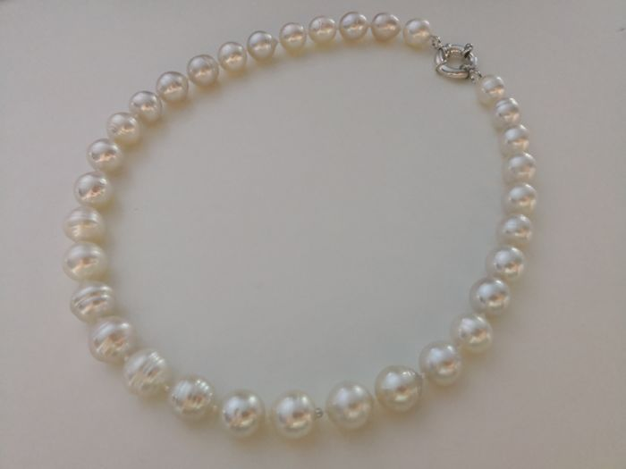 Australian South Sea Pearls necklace 33 pieces 11-13 mm natural color and luster.