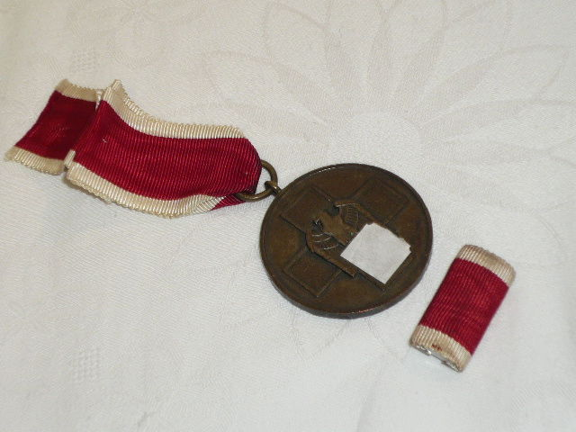 Medal For Care of the German People, bronze, on ribbon, with interim