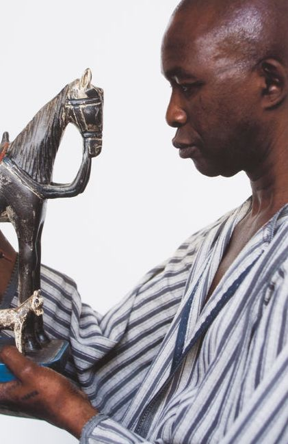 Tiong Ang (1961) - Actor with horse statue