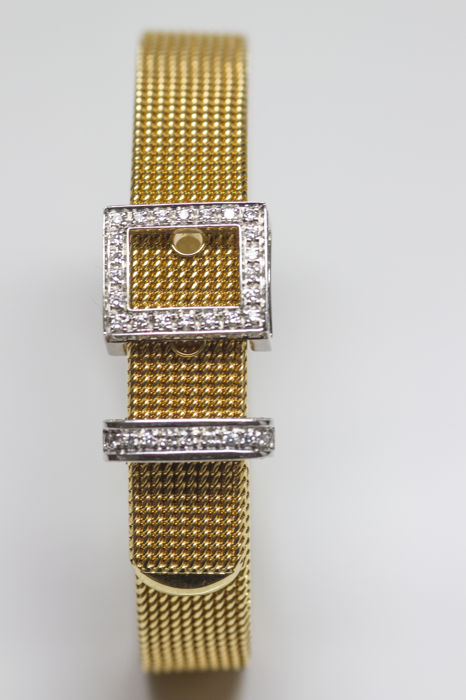 Damiani, 18 kt yellow gold bracelet with a white gold buckle and loop set with 0.66 ct brilliant cut diamond