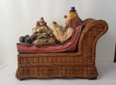 Two lying clowns on wicker sofa - Labelled AAA