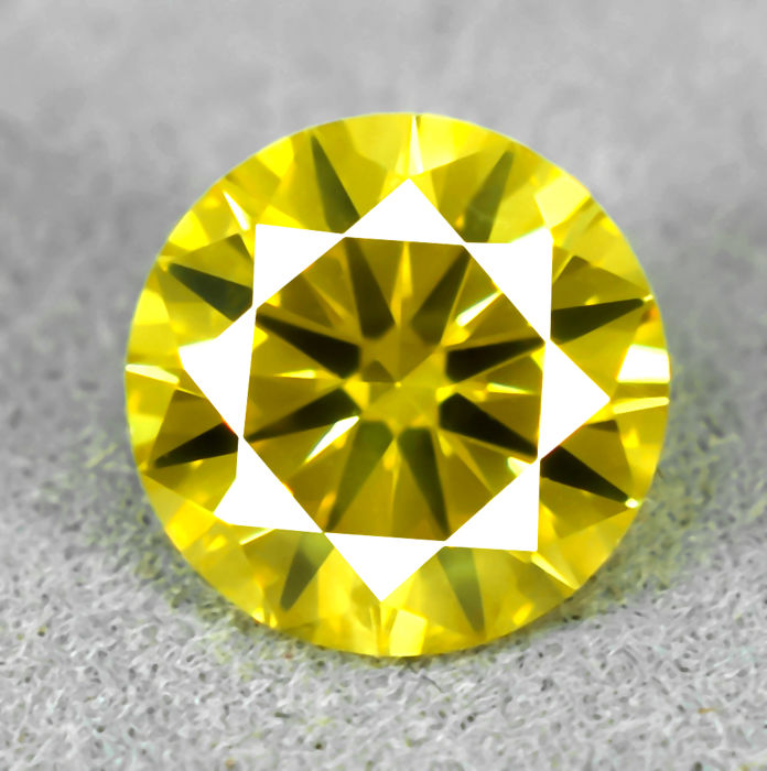 Fancy Yellow (treated) Diamond - 1.06 ct