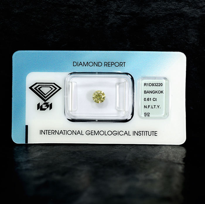 Natural Fancy Light Yellow Diamond - 0.61 ct